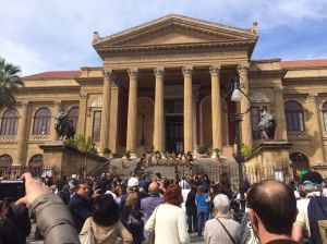 Marching military brass band on the steps of the Teatro Massimo