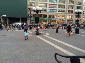Playing football in the middle of people chilling on the steps of Union Square.