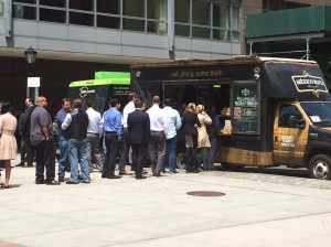 Queueing up at food trucks during lunch break.