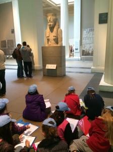 Children sketching Egyptian history in British Museum