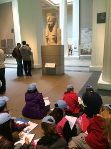 Children sketching Egyptian history in British Museum